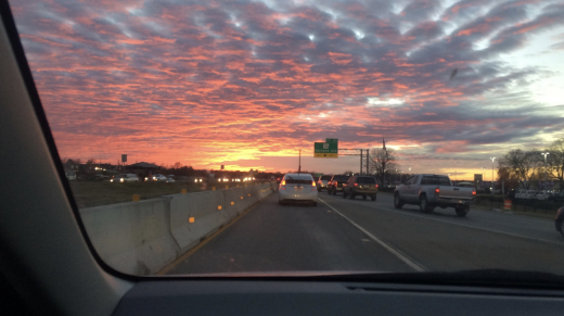 Sunset and Clouds over Highway